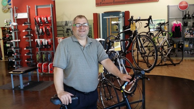 Chris Freeman tries a bike on for size at Village Bike & Fitness