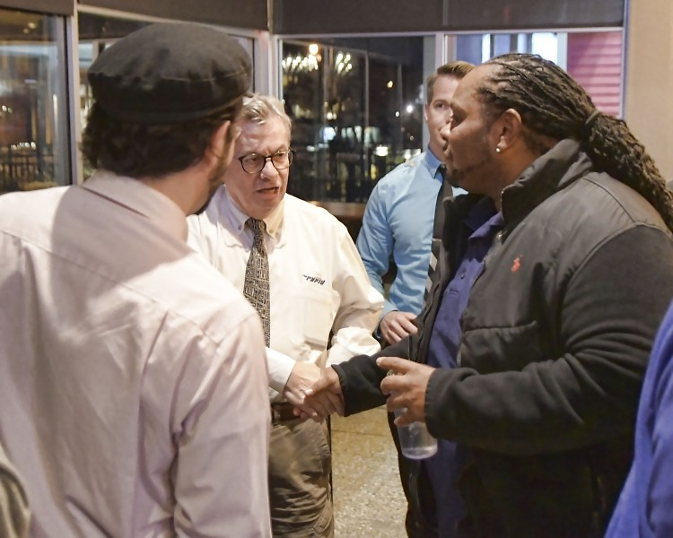 Rapid CEO Peter Varga and ATU Local 836 president RiChard Jackson greeting each other at the transit millage watch party