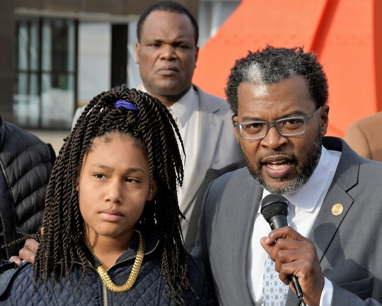 Honestie Hodges and Cle Jackson president of the Greater Grand Rapids NAACP address the media