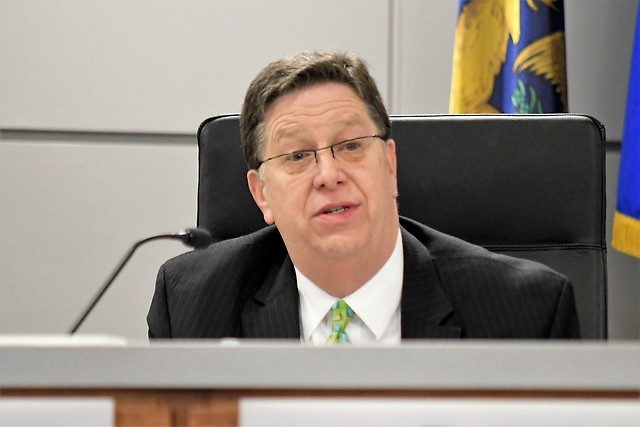 City Manager Greg Sundstrom makes comments at his last City Commission meeting