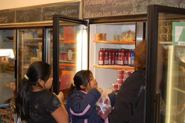 A family is visiting a food pantry in the Access Pantry Network.