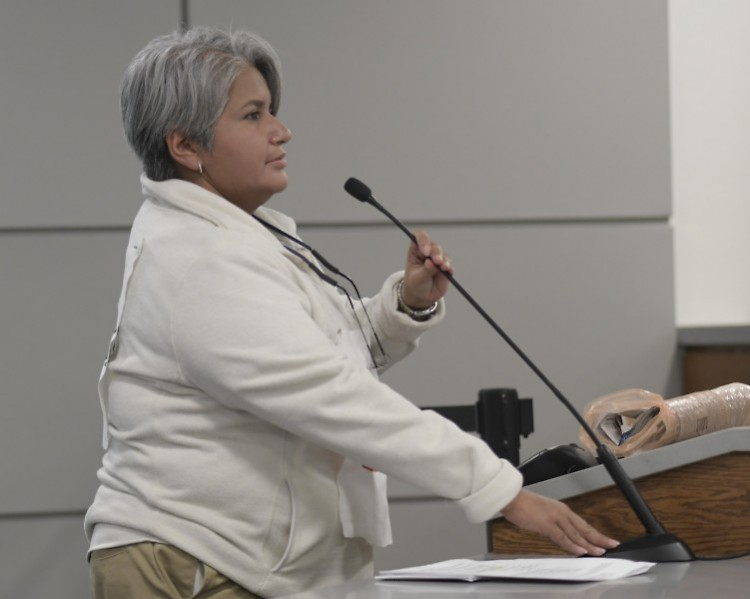 Gema Lowe speaks on behalf of undocumented immigrants at the Grand Rapids City Commission meeting on Novmeber 14, 2017