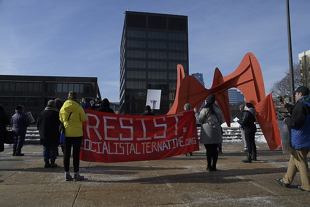 Far-left protesters gather on Calder Plaza on Saturday, January 20, 2018.