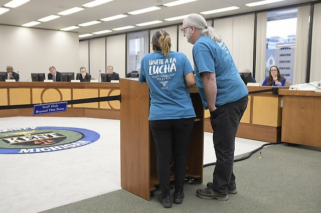 Idalia Tinoco, with translation by Jeff Smith, makes public comment at the Kent County Board meeting.