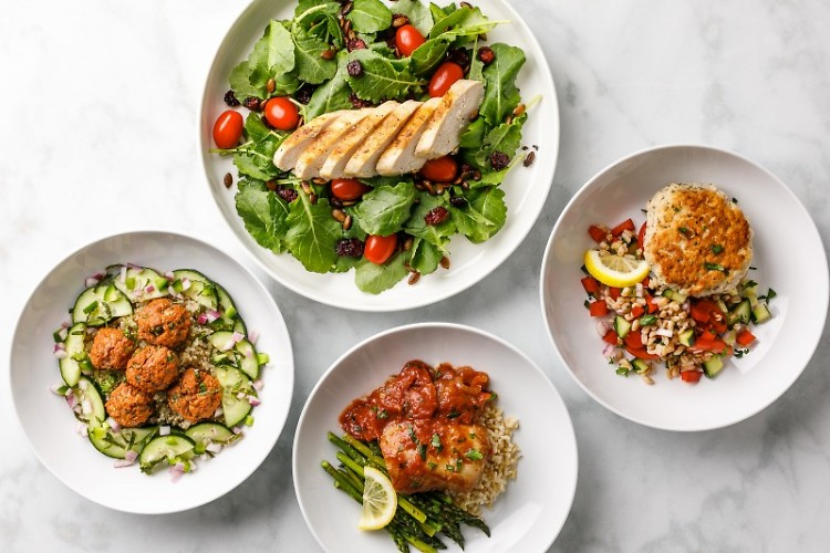 Prepared dishes from Root Functional Medicine's pre-packaged meal service