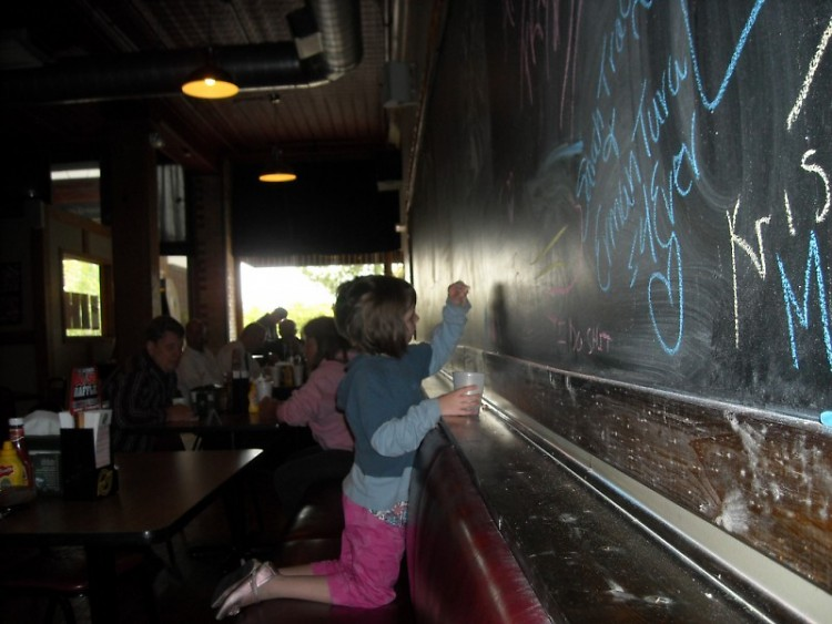 Ritz Koney customers are welcome to draw on a full wall-length chalk board.
