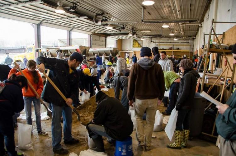 WMEAC volunteers fill sandbags after the 2013 Grand Rapids Flood