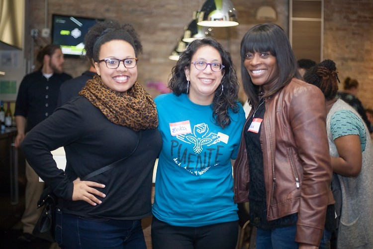 Brandy Arnold, Erika Vandyke and Trina Poston at a UCC happy hour event for people of color.