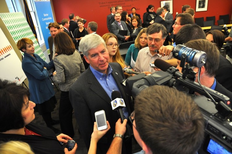 Michigan Governor Rick Snyder answers media questions at MML Lansing Office