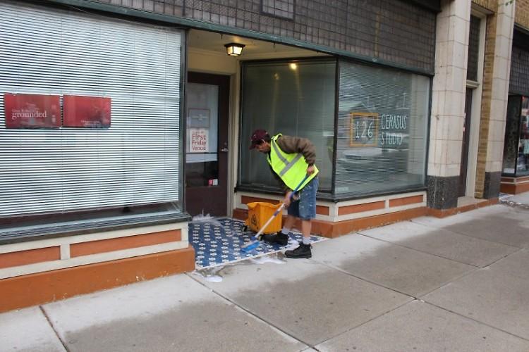 Tony cleaning the neighborhood sidewalks