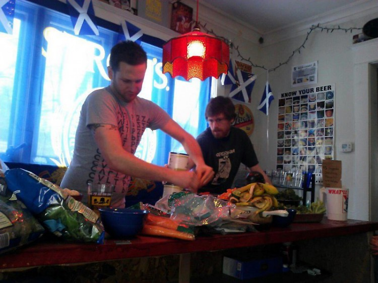 Dallas and Mike cooking up some hot vegan dishes.
