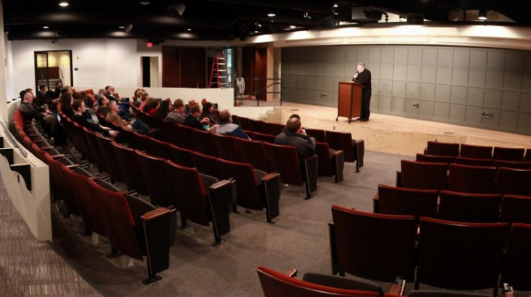 Acton Institute president Father Robert Sirico welcomes staff