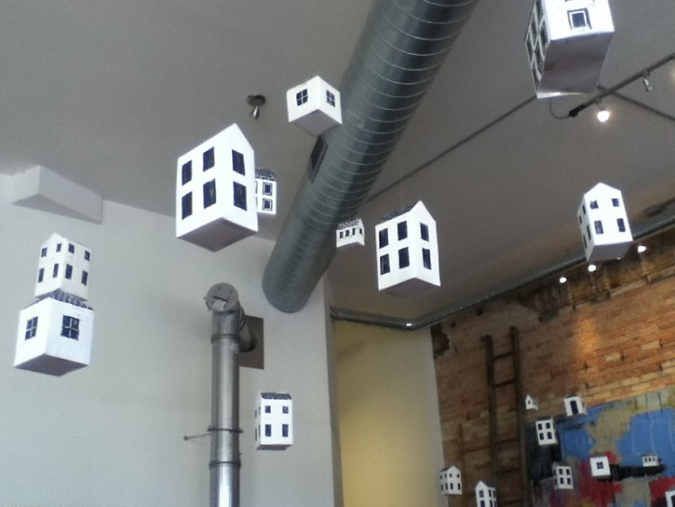 Perspective Lifters hangs from the ceiling at MadCap Coffee