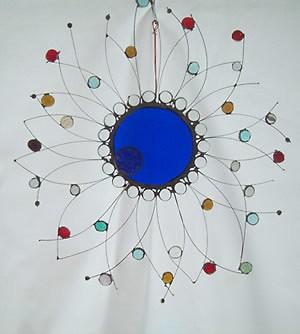 Jim Van Beek - Glass Sculpture: Blue sun face, blue glass, multi-color nuggets, copper wire.