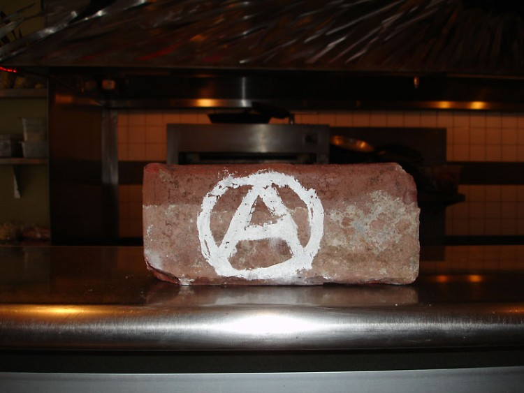 The brick used to smash the windows of Electric Cheetah