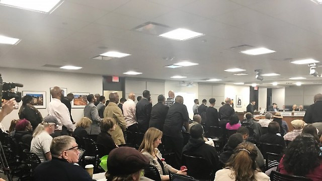 Black men stand in solidarity over concerns with policing at City Commission meeting on Tuesday, May 9, 2017.