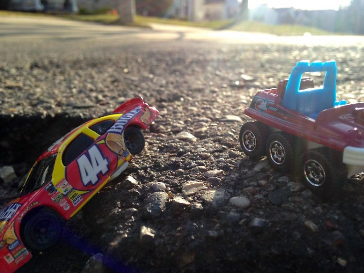 Our managing editor Holly Bechiri used her son's toys and her phone to create scenes in potholes around her neighborhood.