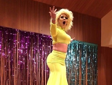 "A drag queen lip syncing ""This is Me"" by Kesha at the Grand Valley drag club show."