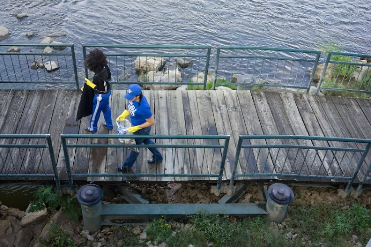 Two volunteers walk along the Grand River at last year's Mayors' Grand River Cleanup