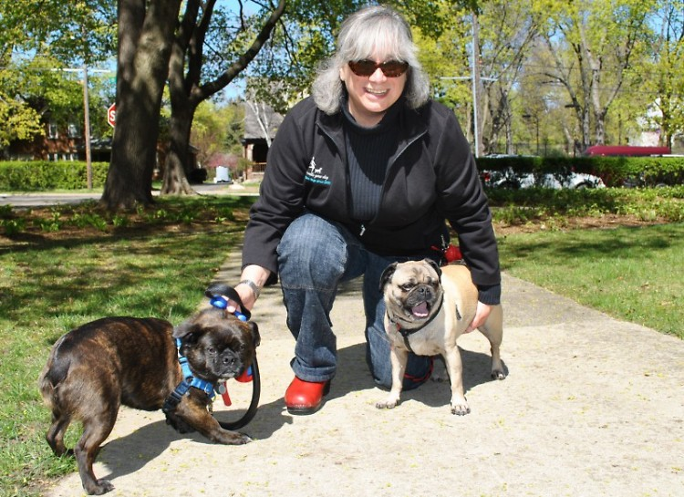 Frances Gentile sits with Phineas, left, and Fergie. She was hired to take them on walks.
