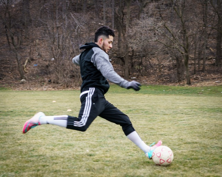 Ernesto Pulido practices soccer at Clemente Park