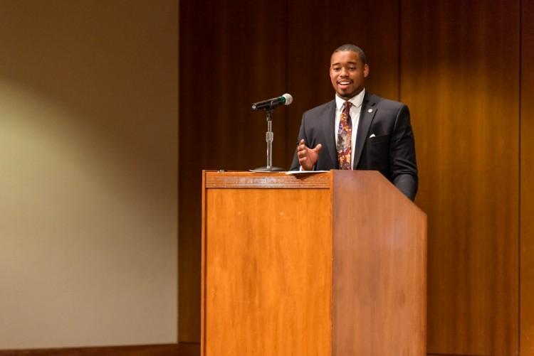 Leighton Watson speaking at Grand Valley State University