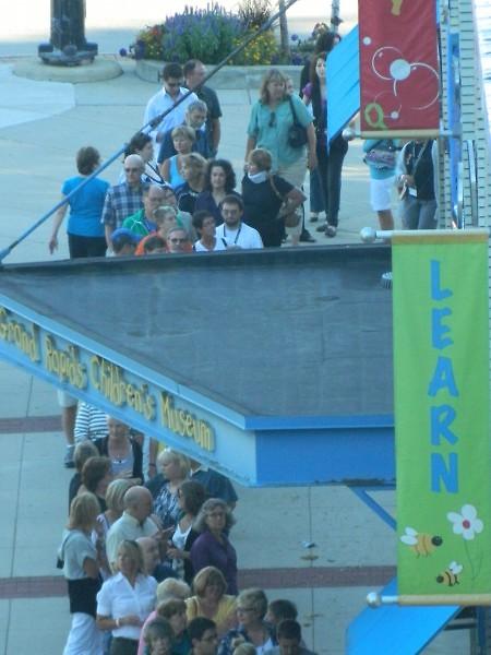 ArtPrize volunteers queue up before the kick-off event