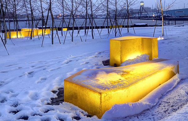 The use of light at Erie Street Plaza to invite people into the plaza during winter