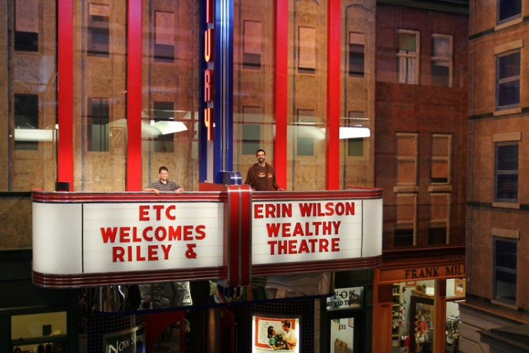 """Erin and Riley Wilson greeted by a marquee welcome sign at ETC, whose lobby is themed entirely on the """"Nighthawks"""" painting."""