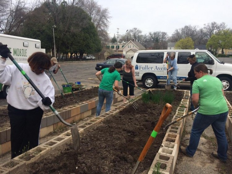 Community garden members prepare beds at Fuller Avenue Christian Reformed Church