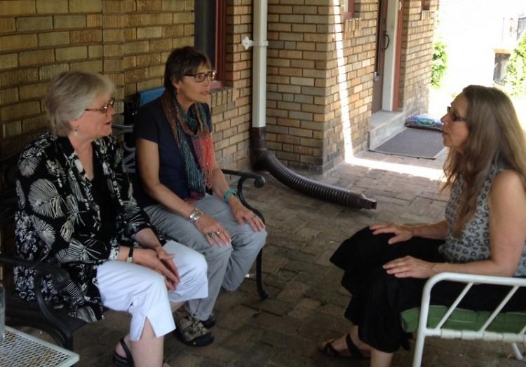 Linda Jones, Annie Garretson, Karen Chalmer sing Threshold songs on Linda's front porch