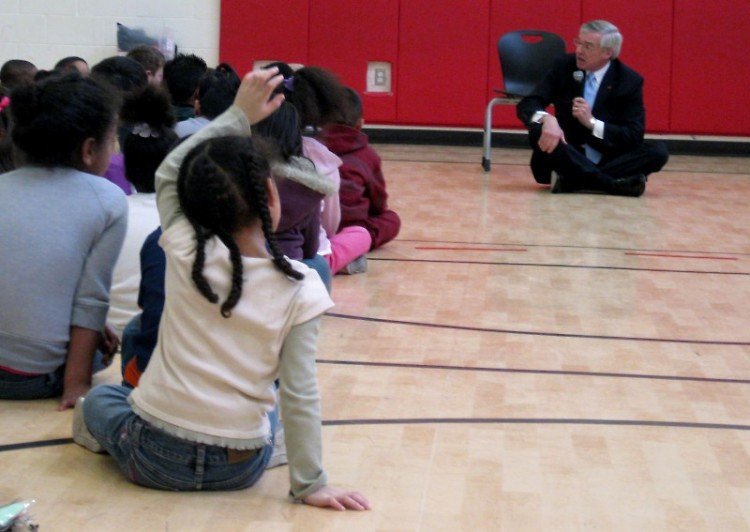 Mayor George Heartwell talks with young students about the importance of reading