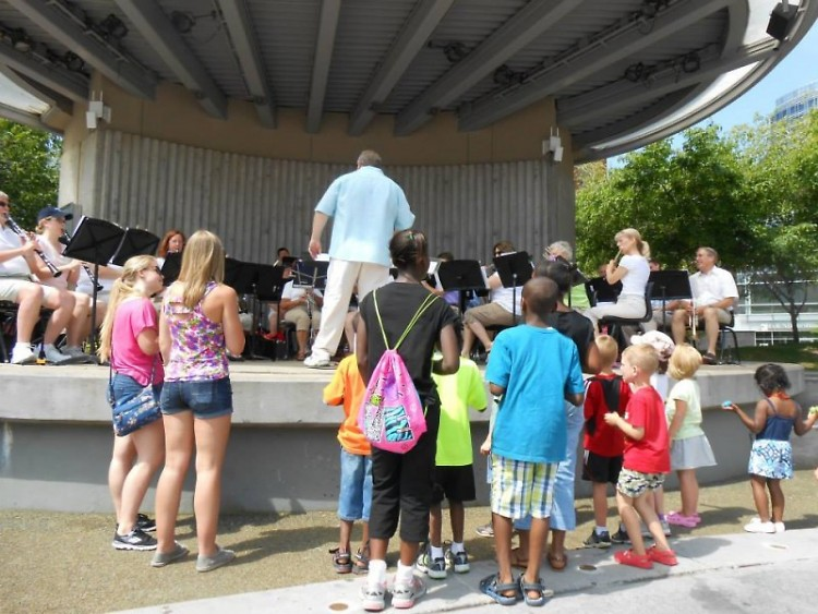 Children watch as Grand Band Camp members perform