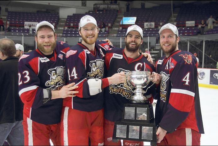 Triston Grant, Brennan Evans, Jeff Hoggan and Nathan Paetsch celebrate Calder Cup victory