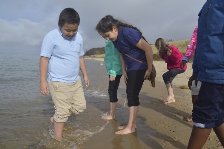 Bravely dipping their feet into the cold water are, left, Alan Ramirez-Becerra and Naudia Radilla-Diego of Stocking Elementary S