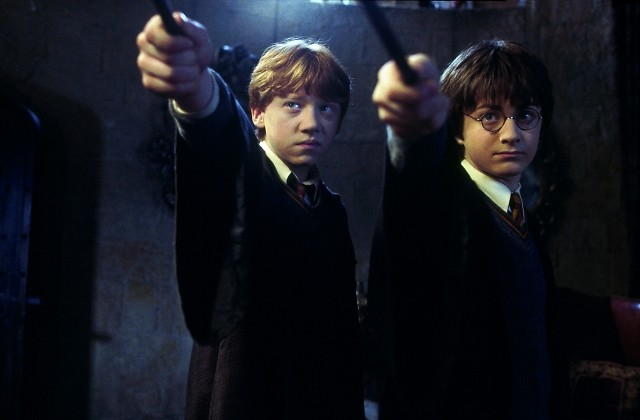 """Rupert Grint (left) as Ron Weasley and Daniel Radcliffe as Harry Potter star in 'Harry Potter and the Chamber of Secrets."""""""
