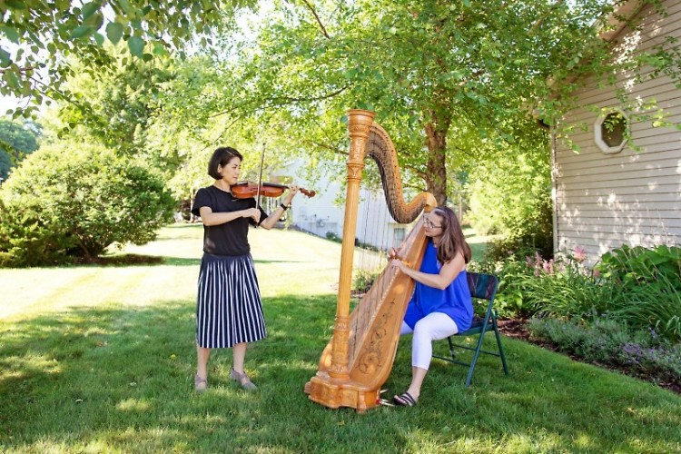 Grand Rapids Symphony musicians performing outdoors.