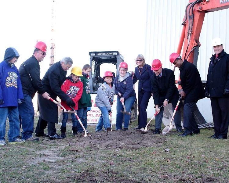 Terry Marshall, George Heartwell, Lynn Rabaut, Tim Gortsema, Tom Almonte and Dave Rue join GYF children to break ground.