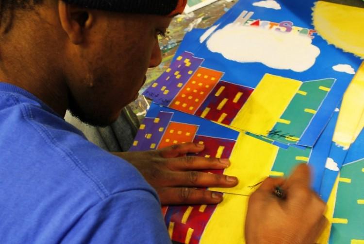 Juwan Kirkpatrick signing his mural print