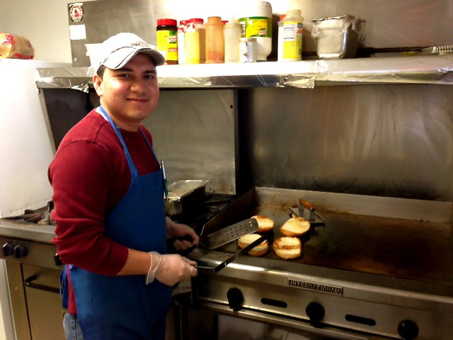 Owner Humberto Alvarez grills up torta bread for customers.