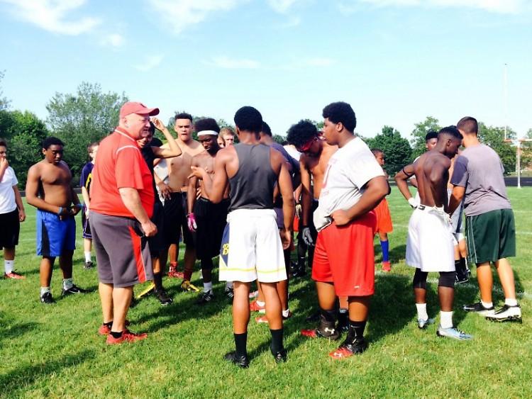 Coach Rick Angstman with the Union Varsity Football Team