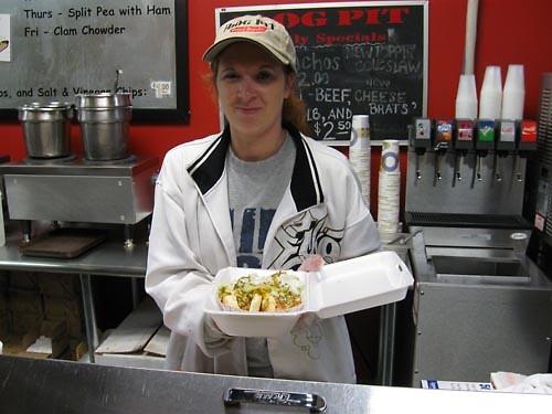 Dog Pit staffer Amy serves up hotdog goodness.