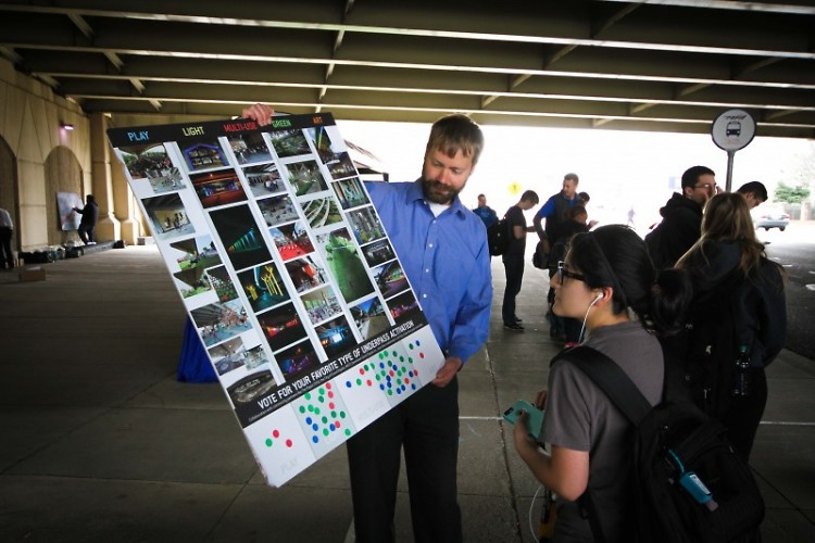 Kevin Wisselink, Senior Planner at The Rapid gathers input from bus rider.