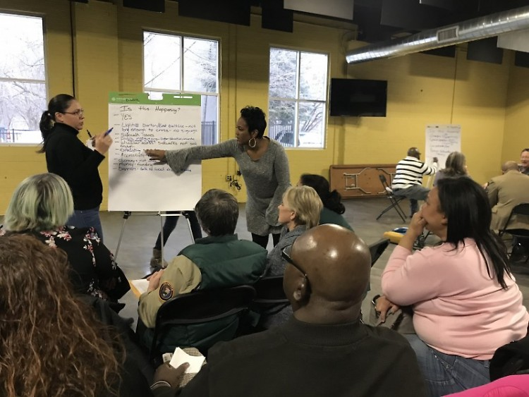 Jackie Hernandez and LaKiya Thompson-Jenkins lead a breakout session during the town hall meeting.