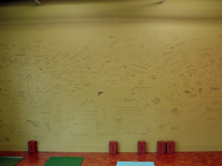 The north wall of the classroom space is being torn down for expansion. Students add their own demons to go with it.