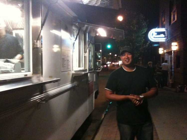 Owner Paul Lee beside What the Truck