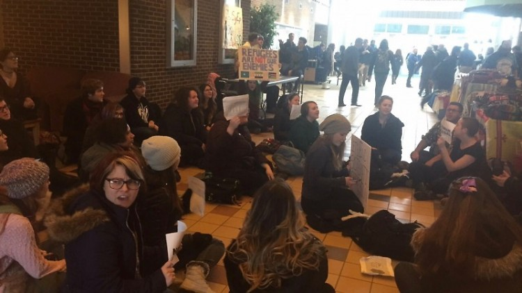 Students protesting in the middle of Kirkhof Center