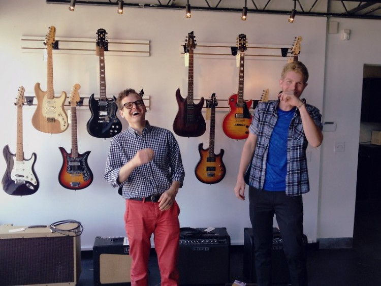 Dean Wiers-Windemuller (left) and Southtown Guitar employee Jesse Bandfield in the store