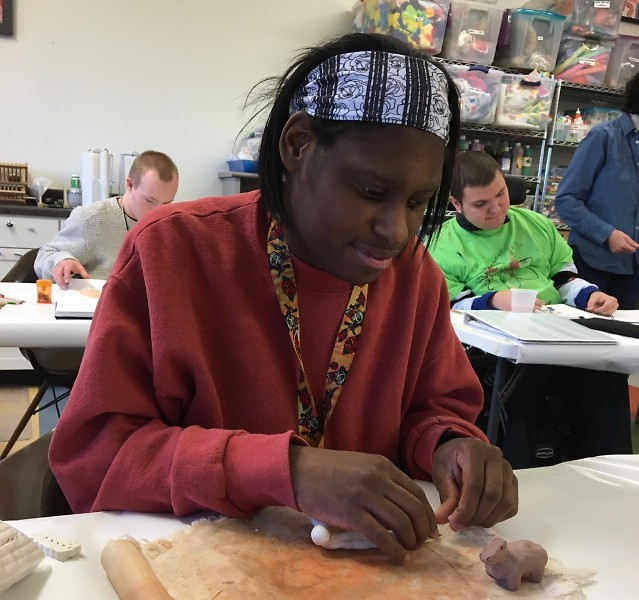 Jasmine Kelley working on a clay project
