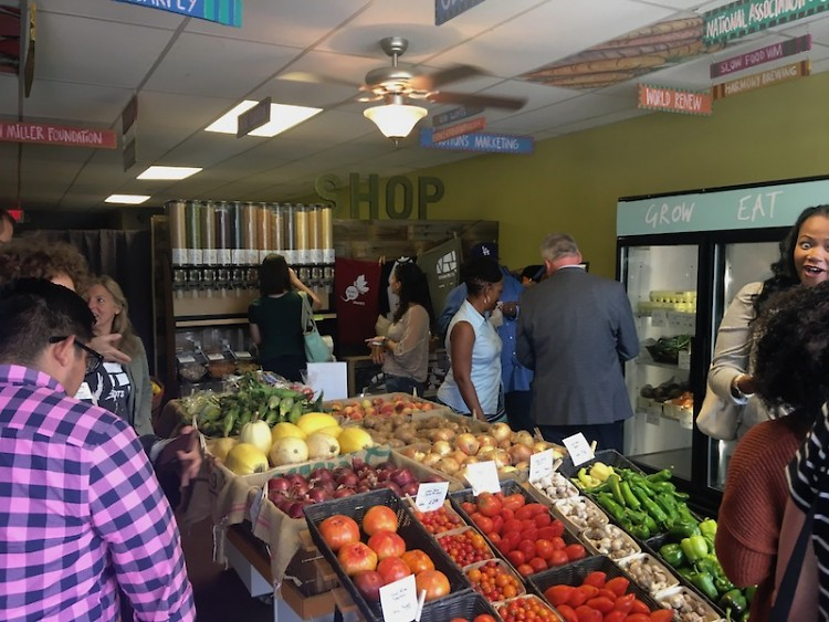 Community members enjoy the market at the Grand Re-Opening Celebration on September 6th.